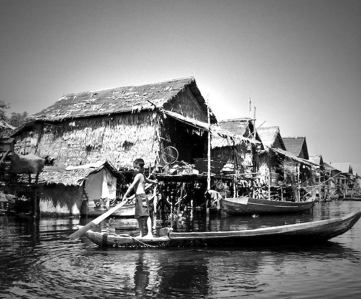 Kid in canoe Kompong Phluk