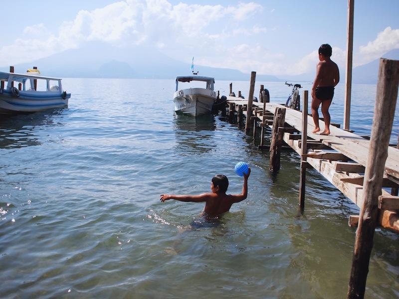 Boy throwing ball in Panajachel